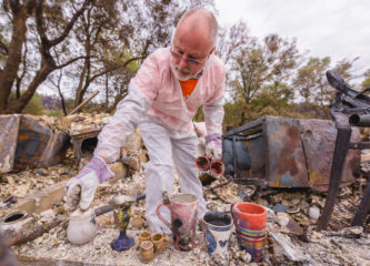 A Samaritan's Purse volunteer recovers precious keepsakes from the ashes of a home in Paradise, Calif.
