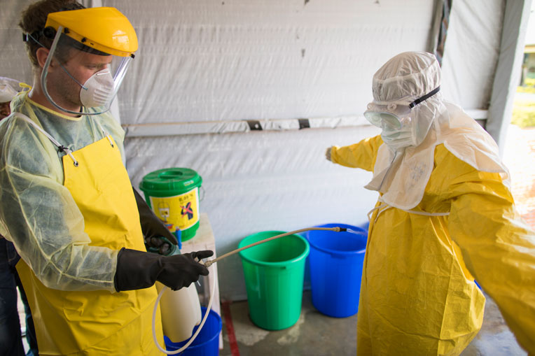 Staff are sprayed with a chlorine solution every time they removing personal protective equipment.