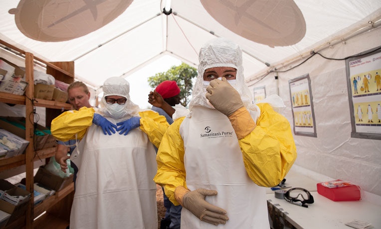 Samaritan's Purse medical teams must don personal protective equipment before caring for Ebola patients. They continue to demonstrate God's love to hurting people in the Democratic Republic of the Congo.