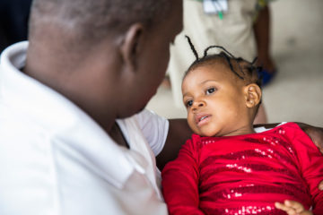 Jerrylyn looks up at her father, Jeremiah, after cataract surgery allowed her to see him clearly for the first time.