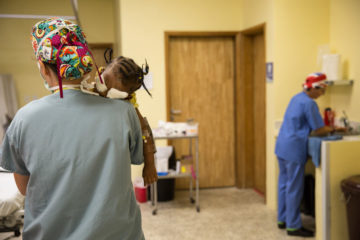 Jerrylyn is carried from the operating room after her cataract surgery.