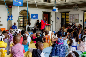 Moise and fellow band members sing at the Greta Home & Academy, to the delight of the boys and girls.