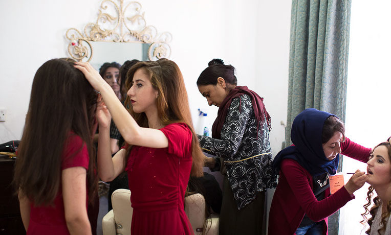 The salon provides an outlet for Yazidi women living in a displacement camp to prepare for family weddings like they would have in their homeland of Sinjar.