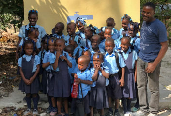 Gabriel (back left) and her classmates are grateful for the water, sanitation, and hygiene facility that Samaritan's Purse built for their school.