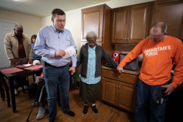 Luther Harrison, Samaritan's Purse Vice President of North American Ministries, prays with Everlena Chambers during dedication of her rebuilt home.