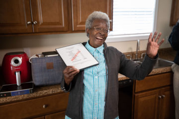 Everlena Chambers celebrates her home newly-renovated by Samaritan's Purse volunteers.