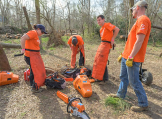 Liberty University students gear up for a day of chainsaw work in Lee County, Alabama.