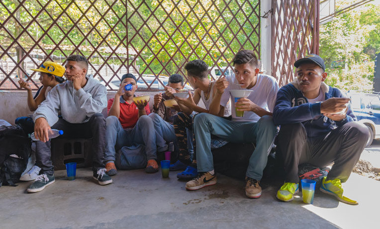 Venezuelan migrants receive hot food at one of the Samaritan's Purse shelters in Colombia.