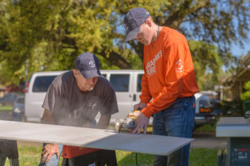Students from College of the Ozarks learn from Samaritan's Purse site leaders how to operate saws and other specialized tools.