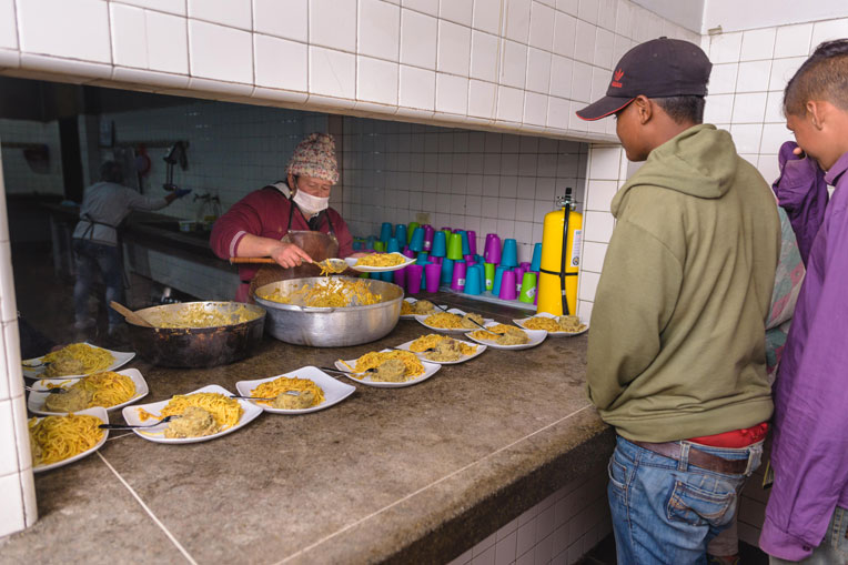 Pasta provides energy to migrants who are typically walking many miles each day.