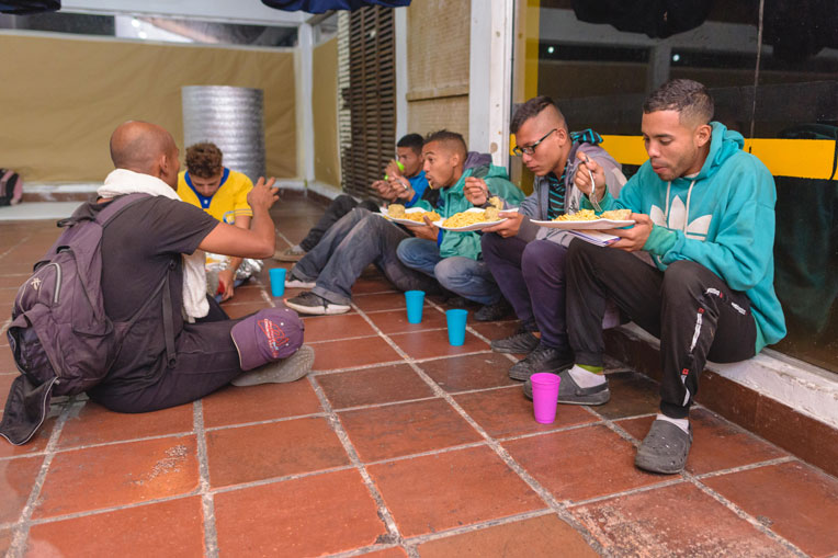 Venezuelan migrants appreciate a hot meal high in the Andes where temperatures can drop below freezing.
