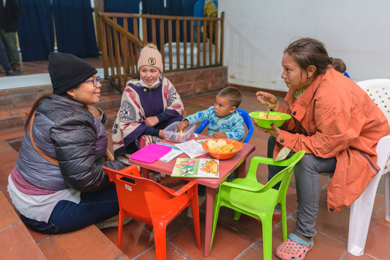 Angelica and her son eat a hearty evening meal at our shelter in Berlin.