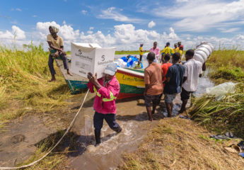 Emergency relief supplies are delivered by boat to remote villages.