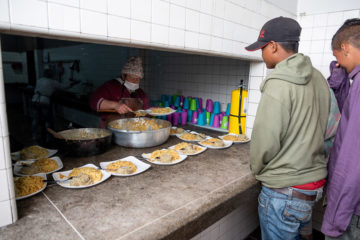 Hot meals are served throughout the day at our migrant shelter in Berlin.