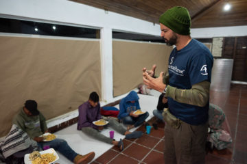 A Samaritan's Purse staff member prays over the evening meal at our shelter.