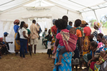 Families wait to be seen by medical staff at the field hospital.