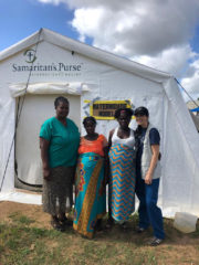 Dr. Maria, right, with a local doctor and two patients.