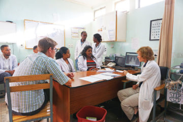 Melisa consults with members of the hospital medical team.