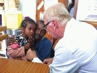 Mark cares for a patient at Soddo Hospital.