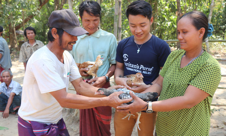 Samaritan's Purse staff in Myanmar are teaching people vulnerable to labor trafficking how to raise chickens so that they can earn an income and remain in their village.