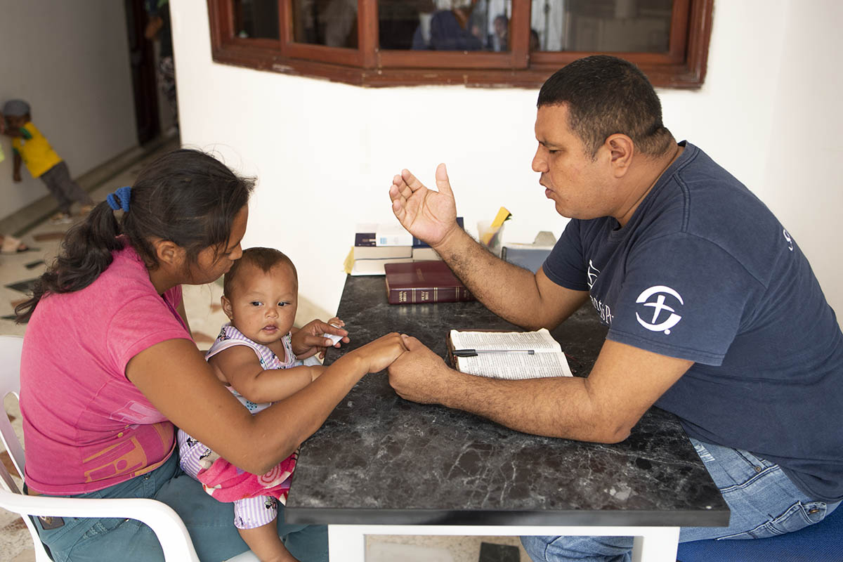 Chaplain praying at Samaritan's Purse clinic in Colombia