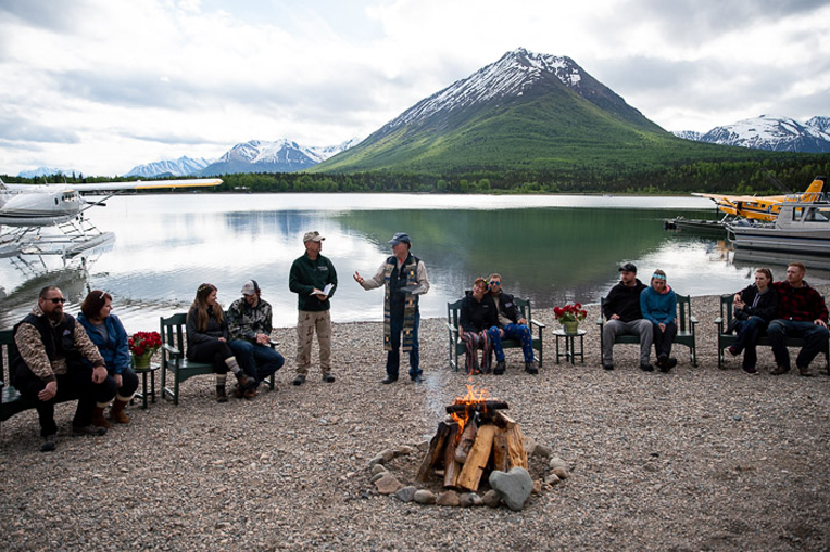 Five military couples gathered on the shores of Lake Clark to rededicate their marriages to Jesus Christ together with Chaplains Emory Lussi (center, left) and Jim Fisher.