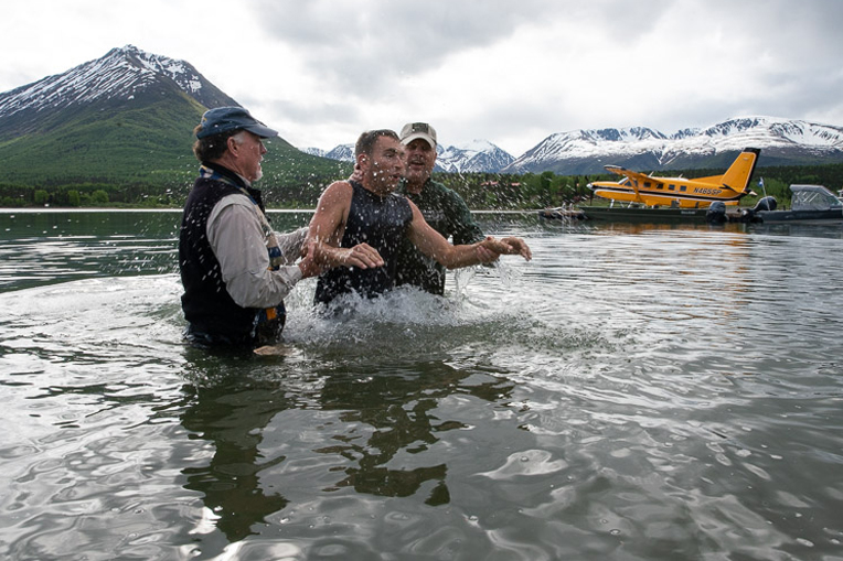 Derek Coble took the opportunity to be baptized in the frigid waters of Lake Clark.