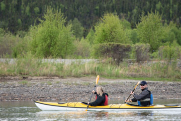 Courtney and Jimmy Hahn kayak on Lake Clark.