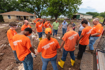 Volunteers pray with the Atchleys during days of work on their flooded home in Muskogee, Oklahoma.