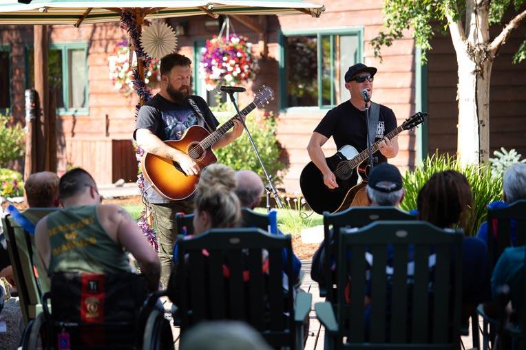 Members of the band Kutless played July 3 at the weekly Wednesday picnic at Samaritan Lodge Alaska.