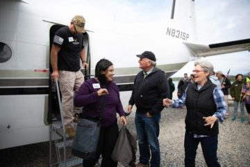 Franklin and Jane Graham greet Victor and Roxana Median as they arrive for a week of marriage enrichment training in Alaska.