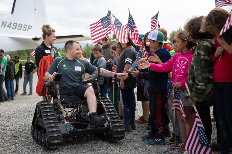Marine Corporal Derrick and Cara Sharpe receive a patriotic welcome at Samaritan Lodge Alaska.