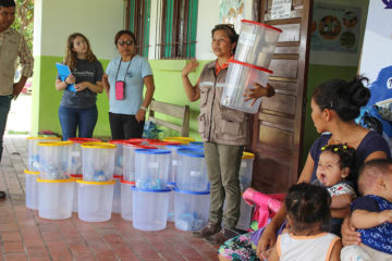 Samaritan's Purse WASH program manager Elianay Loras Castro trains a group of women on how to use the water filters that we are providing.