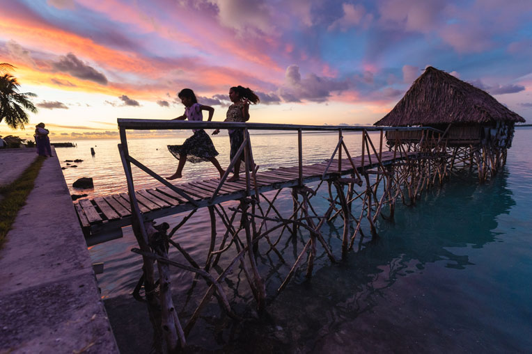 Local children enjoy a sunset on the island, one of many Pacific islands where Samaritan's Purse is seeking to share the Gospel through Operation Christmas Child.