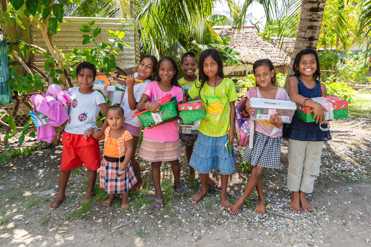 Children gather to celebrate the new gifts they've received. Many of them not only received shoebox gifts but also an opportunity to hear the Gospel of Jesus Christ.