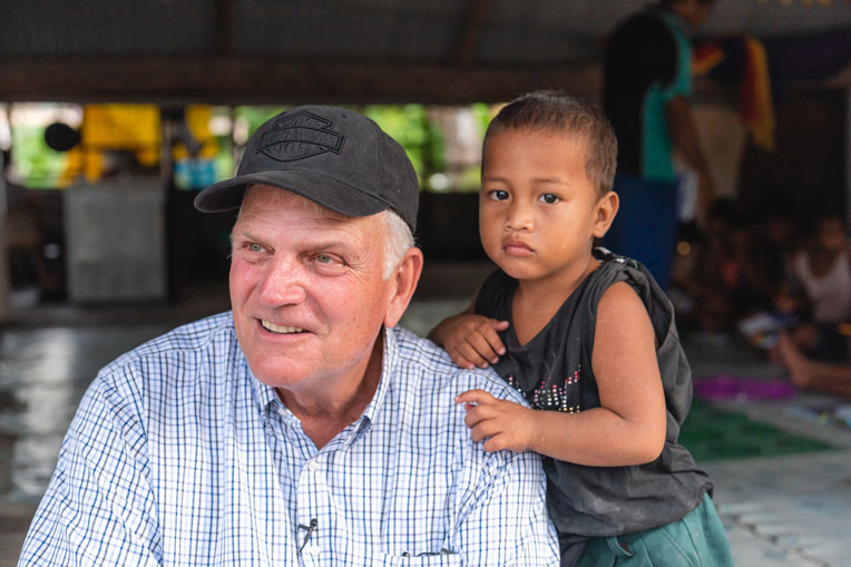 Samaritan's Purse Franklin Graham meets one of many grateful children during an Operation Christmas Child outreach among the villages of Tarawa in the island nation of Kiribati.