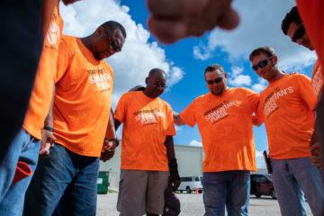 Teams always begin their work day with prayer.