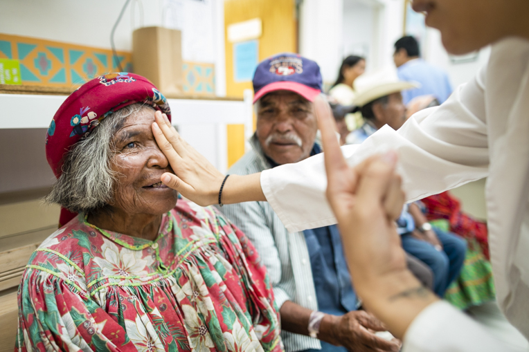Rosario's vision is checked after removing her eye patch.