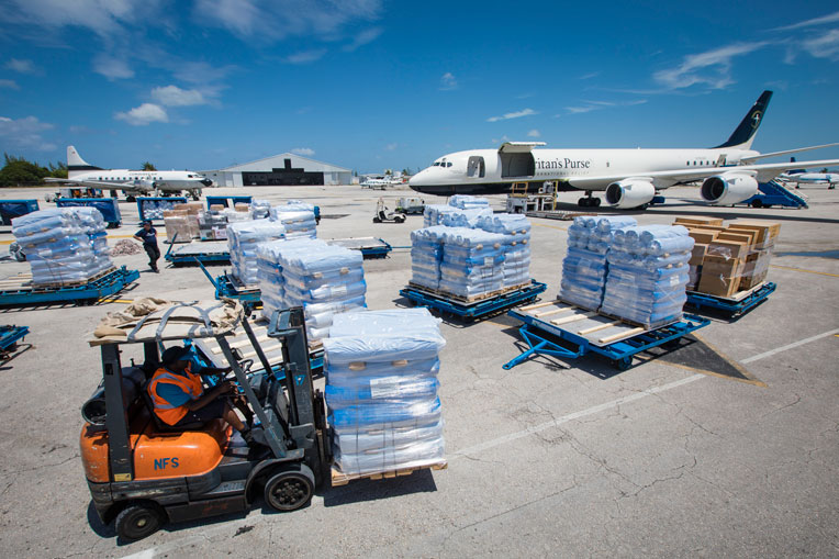 On Sept. 4, teams unload the Samaritan's Purse DC-8 aircraft in the Bahamas with critical supplies.
