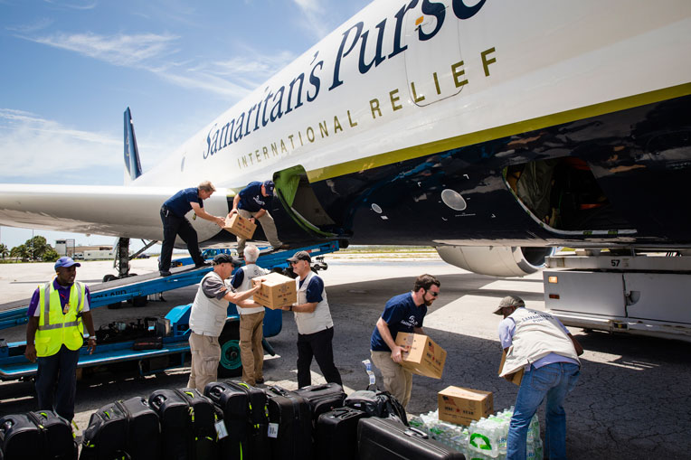 Our staff work hard to unload emergency relief supplies.