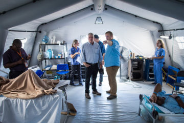 Dr. Elliott Tenpenny, medical director for the Emergency Field Hospital, gave Franklin Graham a tour of the facility on Sept. 16.