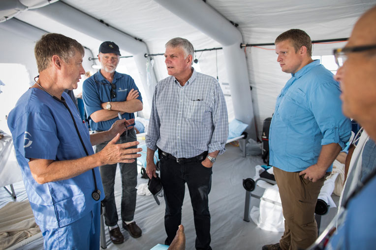 Franklin Graham speaks with our medical team in Freeport, Grand Bahama.
