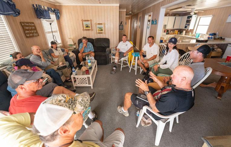 Samaritan's Purse staff, including Ken Isaacs, Cissie Graham Lynch, and Corey Lynch, listen to Man-O-War Cay residents.
