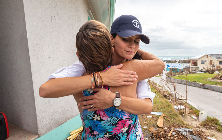 Cissie Graham Lynch shares a hug with Martha Roberts in the Abaco Islands.