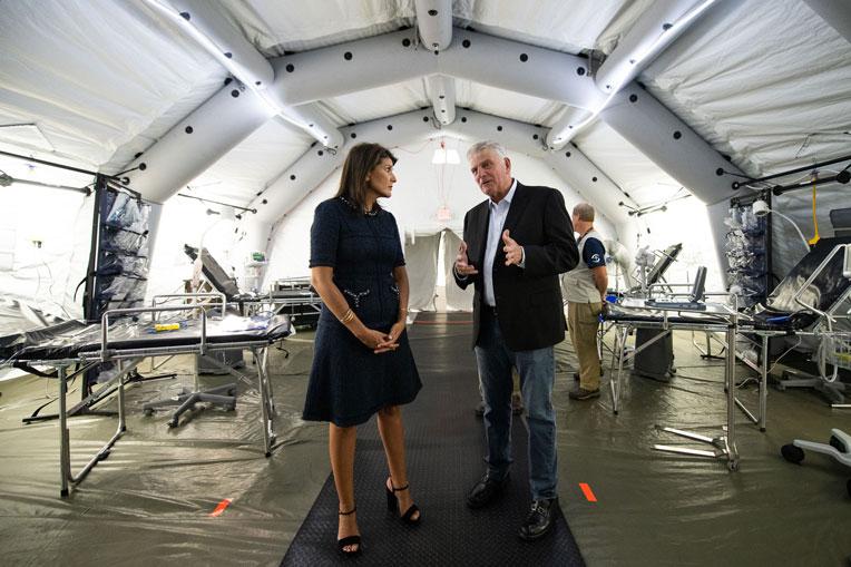 Samaritan's Purse President Franklin Graham provides former U.S. Ambassador Nikki Haley a glimpse of our Emergency Field Hospital on display at the conference.