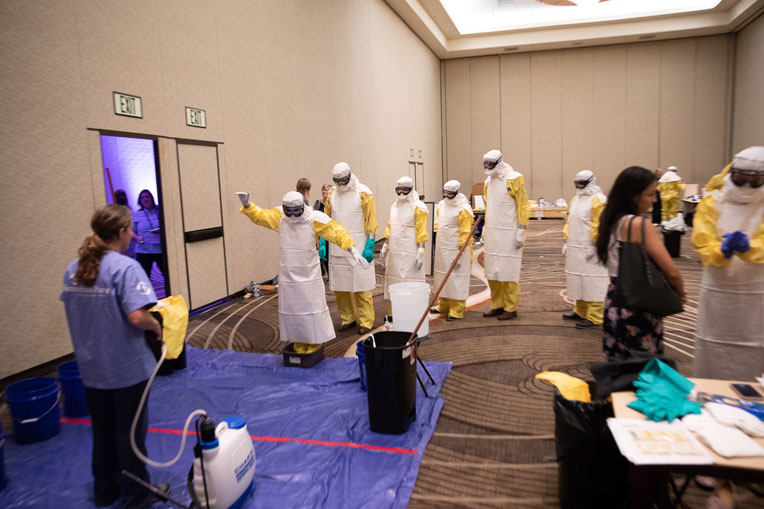 Participants get to experience what it's like to enter an Ebola Treatment Center wearing protective gear used by medical personnel treating patients infected with the deadly virus.