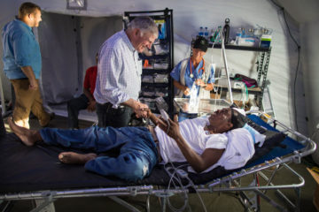 Franklin Graham encourage Kristna Thompson at the Emergency Field Hospital in Freeport.