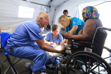 Hurricane survivors, including Lucinda Haven, are being treated at our Emergency Field Hospital.
