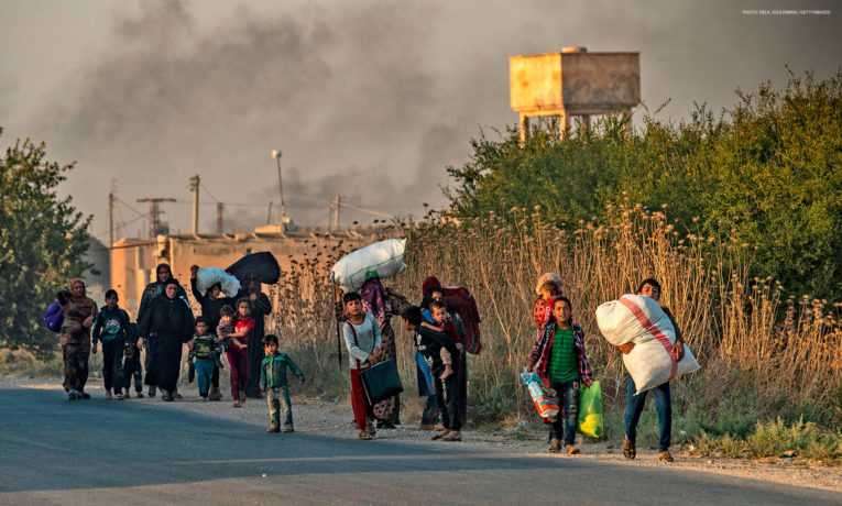 Many are fleeing the violence in northeastern Syria. (Photo by DELIL SOULEIMAN/AFP via Getty Images)