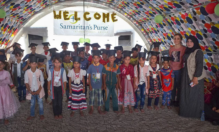 Child Friendly Space participants at a displacement camp in northern Iraq celebrate their graduation from the Samaritan's Purse program.